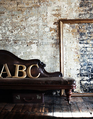 Interior, sofa and big letters.