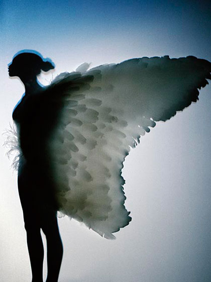 An angel spreads her wings.